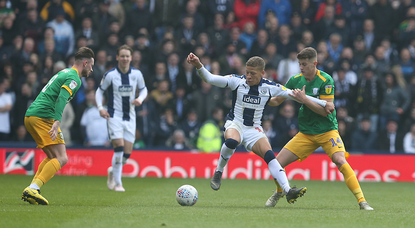 West Bromwich Albion's Dwight Gayle shields the ball from Preston North End's Jordan Storey<br /> <br /> Photographer Stephen White/CameraSport<br /> <br /> The EFL Sky Bet Championship - West Bromwich Albion v Preston North End - Saturday 13th April 2019 - The Hawthorns - West Bromwich<br /> <br /> World Copyright © 2019 CameraSport. All rights reserved. 43 Linden Ave. Countesthorpe. Leicester. England. LE8 5PG - Tel: +44 (0) 116 277 4147 - admin@camerasport.com - www.camerasport.com