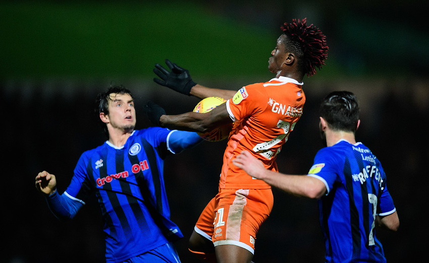 Blackpool's Armand Gnanduillet vies for possession with Rochdale's Jordan Williams, left, and Rochdale's Joe Rafferty<br /> <br /> Photographer Chris Vaughan/CameraSport<br /> <br /> The EFL Sky Bet League One - Rochdale v Blackpool - Wednesday 26th December 2018 - Spotland Stadium - Rochdale<br /> <br /> World Copyright © 2018 CameraSport. All rights reserved. 43 Linden Ave. Countesthorpe. Leicester. England. LE8 5PG - Tel: +44 (0) 116 277 4147 - admin@camerasport.com - www.camerasport.com