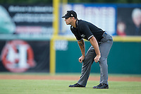 Umpire Justin Robinson handles the calls on the bases during the South Atlantic League game between the Charleston RiverDogs and the Hickory Crawdads at L.P. Frans Stadium on August 25, 2015 in Hickory, North Carolina.  The Crawdads defeated the RiverDogs 7-4.  (Brian Westerholt/Four Seam Images)