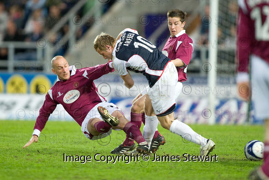 05/05/2010   Copyright  Pic : James Stewart.sct_js010_falkirk_v_st_johnstone  .::  PAUL SHEERIN AND JOSHUA FALKINGHAM CHALLENGE SCOTT ARFIELD ::  .James Stewart Photography 19 Carronlea Drive, Falkirk. FK2 8DN      Vat Reg No. 607 6932 25.Telephone      : +44 (0)1324 570291 .Mobile              : +44 (0)7721 416997.E-mail  :  jim@jspa.co.uk.If you require further information then contact Jim Stewart on any of the numbers above.........