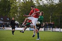 VOETBAL: JUBBEGA: Sportpark 't Heidefjild, 16-05-2012, Nacompetitie, Zondag 4e klasse B, SC Boornbergum'80 - Haulerwijk, Eindstand 2-1, Jan Wierd Ritsema (#12 | HW) en Tim vd Velde (#4 | HW) in duel met Patrick Fiene (#12 | BB), ©foto Martin de Jong