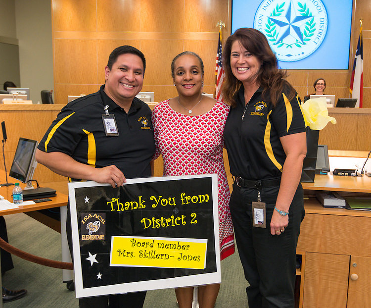 Houston ISD trustee Rhonda Skillern-Jones, center, is recognized by Issacs ES principal Rosemarie Cummings, right, and assistant principal Cesar Alvarez, left, September 12, 2013.