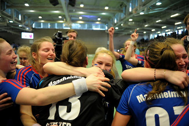 GER - Luebeck, Germany, February 07: Players of Mannheimer HC celebrate after winning the shootout during the 1. Bundesliga Damen indoor hockey final match at the Final 4 between Mannheimer HC (blue) and Duesseldorfer HC (white) on February 7, 2016 at Hansehalle Luebeck in Luebeck, Germany. Final score 6-4 after shootout. (Photo by Dirk Markgraf / www.265-images.com) *** Local caption *** (L-R) Laura Bassemir #25 of Mannheimer HC, Nadine Stelter #13 of Mannheimer HC, Laura Bassemir #25 of Mannheimer HC