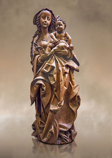 """Wooden Gothic sculpture of the Virgin and Child attributeed to Martin Hoffman from the city of Basle, 1507, Switzerland. From the Commandry of Isenheim, Haut Rhin. This sculpture is probably the """"big and ancient wooden statue of the Virgin"""" cited in 1793 in the inventory of the property of the Commandry of Isenheim.  The vervatious deep folds in the Virgins dress, the laughing child Jesus  and the style of Mary were repeatedly imitated in Basel at the beginning of the sixteenth century. This masterpiece of the German late Gothic sculpture was executed in a Basel workshop and can be attributed to Martin Hoffman. Expressive and enigmatic, the style of this masterpiece is the heir of the sculpture schools of Stragbourg and Veit Stoss Franconian art.  Inv RF 1833 The Louvre Museum, Paris."""