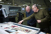 Final edition of the Hungarian photo magazine Fotos Szem (Photographer Eye) undergoes the process of printing at the Pauker printing company in Budapest, Hungary. Wednesday, 13. January 2010. ATTILA VOLGYI