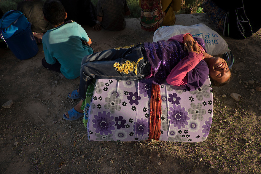 The Mohammad family are Kurdish Syrians from Tal Abyad, who were among the thousands of refugees who fled into Turkey last week. Moneyless and homeless, they move their belongings from place to place, sometimes sleeping outdoors or in unfinished buildings in a poor neighborhood of Akcakale, Turkey. Last week battles raged between ISIS and the Kurdish YPG forces and other militias and more than 6000 people fled to Turkey.