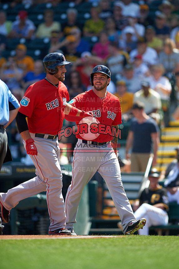 Boston Red Sox Travis Shaw (left) and Blake Swihart (right) after scoring a run during a Spring Training game against the Pittsburgh Pirates on March 9, 2016 at McKechnie Field in Bradenton, Florida.  Boston defeated Pittsburgh 6-2.  (Mike Janes/Four Seam Images)