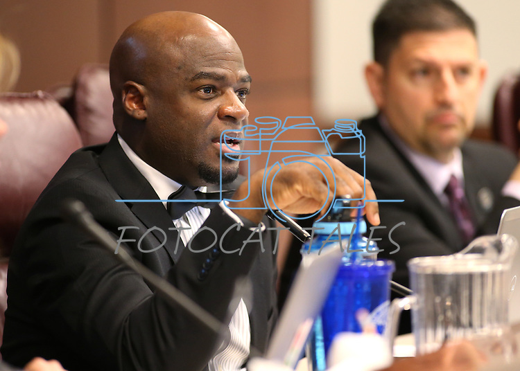 Nevada Sen. Kelvin Atkinson, D-Las Vegas, works in committee at the Legislative Building in Carson City, Nev., on Wednesday, March 4, 2015. <br /> Photo by Cathleen Allison