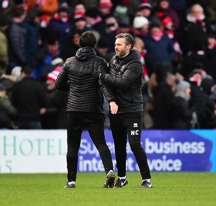 Lincoln City manager Danny Cowley, left, and Lincoln City's assistant manager Nicky Cowley celebrate at the end of the game<br /> <br /> Photographer Andrew Vaughan/CameraSport<br /> <br /> The EFL Sky Bet League Two - Lincoln City v Grimsby Town - Saturday 19 January 2019 - Sincil Bank - Lincoln<br /> <br /> World Copyright © 2019 CameraSport. All rights reserved. 43 Linden Ave. Countesthorpe. Leicester. England. LE8 5PG - Tel: +44 (0) 116 277 4147 - admin@camerasport.com - www.camerasport.com