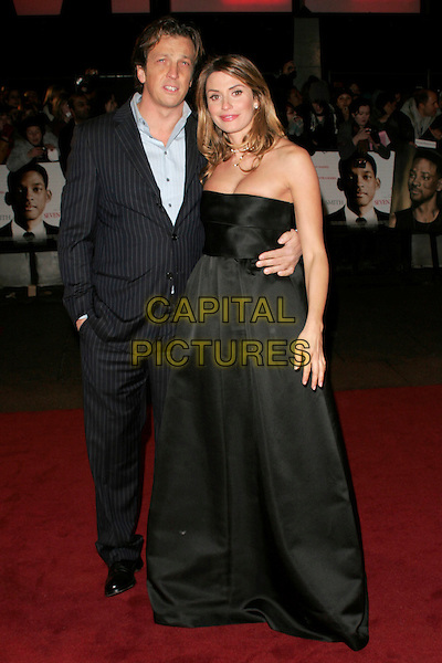 "GABRIELE MUCCINO & ANGELICA RUSSO.The UK film premiere of ""Seven Pounds"" at the Empire Cinema, Leicester Square, London, England..January 14th 2009.full length blue pinstripe suit strapless black long maxi dress hand in pocket .CAP/AH.©Adam Houghton/Capital Pictures."