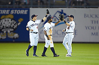 (L-R) Toledo Mud Hens outfielders Mikie Mahtook (8), Christin Stewart (20), and Mike Gerber (10) celebrate their win over the Louisville Bats at Fifth Third Field on June 16, 2018 in Toledo, Ohio. The Mud Hens defeated the Bats 7-4.  (Brian Westerholt/Four Seam Images)