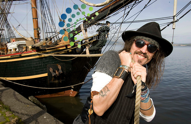 Johnny Depp lookalike pulls the HMS Bounty on the Greenock quayside. Bounty, a recreation of the 18th century three masted square rigger, which was sailed by Lt. William Bligh, is on a flying visit as part of her whistle-stop tour of Britain on September 12 and 13.  The famous tall ship was built for the 1962 movie, Mutiny on the Bounty that featured Marlon Brando and more recently alongside Captain Jack Sparrow aka Johnny Depp in Pirates of the Caribbean Dead Man's Chest.  Her visit is being facilitated by Riverside Inverclyde and she will be open to all from 11am to 5pm both days. <br /> 11 September 2009: Universal News and Sport (Scotland)<br /> <br /> <br />  Picture: Universal News And Sport (Scotland).............. ........... .