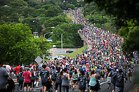 In this image, thousands of runners overtake Enfield Street during the 2016 Statesman Capitol 10K run through downtown Austin, Texas.