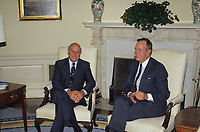 Washington DC., USA, September 24,1990<br /> South African President F.W. de Klerk sits with US. President George H.W.Bush in Oval Office of the White House during a formal photo op. During de Klerk's official visit to the United States to discuss the poetical changes under way in South Africa. Before starting this visit to the United States De Klerk ended the emergency-decree rule in three of the nation's four provides; repelled the Separate Amenities Act, which allowed local officials to reserve public facilities for whites; desecrated hospitals, and most recently called for his National Party, which introduced the apartheid system of racial separation to open membership to all races. Credit: Mark Reinstein/MediaPunch