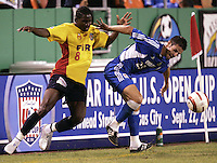 Damani Ralph, left, battles Alex Zotinca, right, for the ball during Kansas City's 1-0 victory over Chicago to win the US Open Cup, at Arrowhead Stadium, in Kansas City, MO, Wednesday, Sept., 22, 2004.