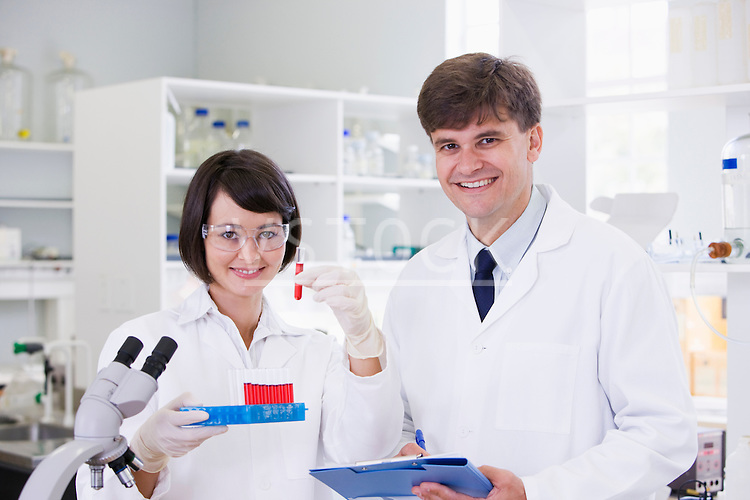 Two scientist in laboratory, portrait