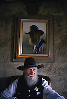 "Ralph Hooker, 90-year-old US Marshall who thinks the guy that came up with ""Miranda rights"" ought to be shot. Once an ancient sea, its uplifted floor untouched by scouring glaciers that stopped to the north.  Eons of erosion carved deep valleys into the Ozarks crusty limestone plateau, transforming its flat surface into the unlikely role of hills.  They march nearly level into the distance, and peak at 2,600 feet in Arkansas's Boston Mountains...  Ozarks region in Missouri and Arkansas by Randy Olson for National Geographic Magazine."