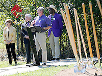 NWA Democrat-Gazette/DAVID GOTTSCHALK   Adella Gray (from left), alderwoman for the city of Fayetteville, Steve Clark, president of the Fayetteville Chamber of Commerce, Lioneld Jordan, mayor, and Robert Bradley, community liaison for the Elizabeth Richardson Center, participate in a groundbreaking ceremony Wednesday, September 2, 2015 for the 1.5 mile extension of Rupple Road to Martin Luther King Jr. Boulevard. The $7.3 million construction project is expected take about a year to complete.