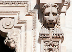 The carved details of a lion and an angel on the facade of the Duomo (Cathedral) in Milan, Italy.
