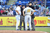 Asheville Tourists manager Warren Schaeffer (13) umpire John Budka West Virginia manager Wyatt Toregas (15) and home plate umpire Dillon Wilson try to sort everything out after a benches clearing brawl during a game at McCormick Field on May 10, 2017 in Asheville, North Carolina. The Tourists defeated the Power 4-3. (Tony Farlow/Four Seam Images)