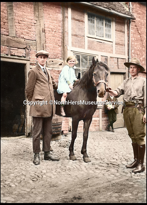BNPS.co.uk (01202 558833)<br /> Pic: NorthHertsMuseumsService/BNPS<br /> <br /> ***Please Use Full Bylne***<br /> <br /> A young girl on horse back poses for a photo with a Canadian trooper c.1917. <br /> <br /> Black and white photos of British Tommies preparing for the First World War have been brought to life after they were digitally colourised to mark the 100th anniversary of the start of the conflict.<br /> <br /> Some of the snaps show soldiers in vivid colour getting battle-ready at training camps in the Home Counties in July 1914.<br /> <br /> Others depict the men dressed in their smart green uniforms on parade in a market square on the eve of war and then stood on a train station platform as they head off for France.<br />  <br /> As well as being filled with colour, some of the photos are tinged with poignancy as many of the men pictured never came back.