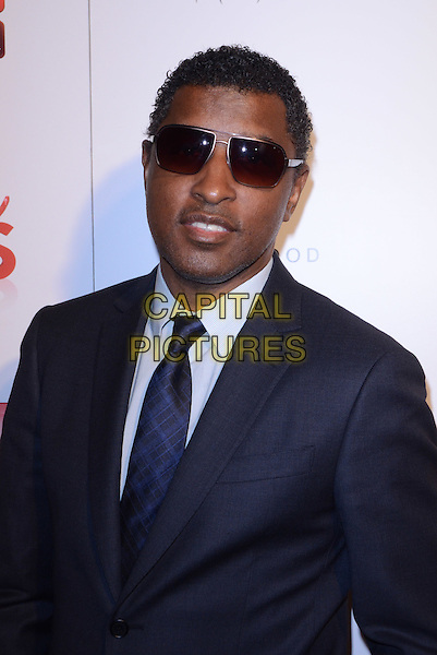 "KENNETH ""BABY FACE"" EDMONDS.Season 2 Premiere Party of TV Guide Network's ""Nail Files"" held at Station Hollywood at W Hotel, Los Angeles, California, USA..August 19th, 2012.half length blue suit tie shirt sunglasses shades .CAP/ADM/TW.©Tonya Wise/AdMedia/Capital Pictures."