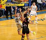 BROOKINGS, SD - FEBRUARY 8: Tagyn Larson #24 of the South Dakota State Jackrabbits lays the ball up past Josie Filer #25 of the Omaha Mavericks at Frost Arena February 8, 2020 in Brookings, South Dakota. (Photo by Dave Eggen/Inertia)