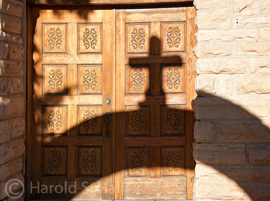 The shadow of a cross is cast on a church in Duran, New Mexico