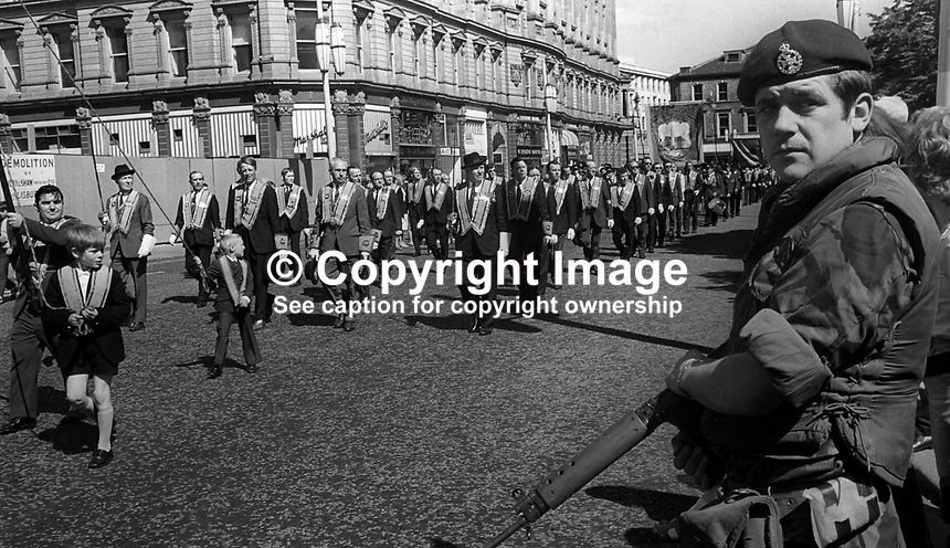 British soldier, one of many, on duty during the annual Twelfth Parade by Orangemen in Belfast, N Ireland, UK, 12th July 1971. 197107120557a<br /> <br /> Copyright Image from Victor Patterson, 54 Dorchester Park, Belfast, UK, BT9 6RJ<br /> <br /> t1: +44 28 9066 1296<br /> t2: +44 28 9002 2446<br /> m: +44 7802 353836<br /> <br /> e1: victorpatterson@me.com<br /> e2: victorpatterson@gmail.com<br /> <br /> www.victorpatterson.com<br /> <br /> IMPORTANT: Please see my Terms and Conditions of Use at www.victorpatterson.com