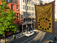 The banner of the New York Studio School of Drawing, Painting and Sculpture hangs over Eighth Street in Greenwich Village in New York on Thursday, May 17, 2017.  The Whitney Museum of American Art originally occupied the building from its beginning in 1931 until 1954. (© Richard B. Levine)