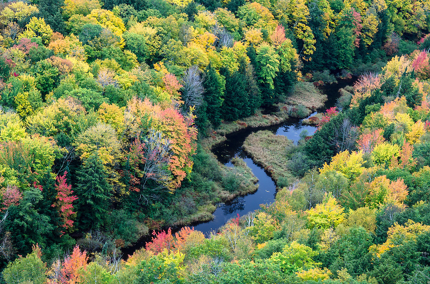 The Big Carp River winding through a valley of fall color. Porcupine Mountains