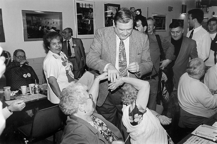 "Rep. Daniel David ""Dan"" Rostenkowski, D-Ill., Chairman of the Ways and Means Committee shaking hands as he leaves a campaign appearance with seniors playing bingo. Febuary 19, 1994 (Photo by Chris Martin/CQ Roll Call)"