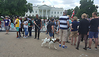 Washington, DC, July 9, 2016, USA--A Uniformed Secret Service K-9 officer walks through a crowd of tourist in front of the White House.  Increased security has been ordered around the Washington DC area because of the recent incisidents of violence.  Patsy Lynch/MediaPunch