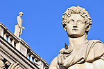 Marble statue topping the steps to Piazza del Campidoglio in Rome, Italy.