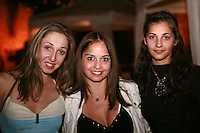 September 23, 2007; Patras, Greece;  (L-R) Elizabeth Paisieva of Bulgaria, Anahi Sosa of Argentina and Stela Sultanova of Bulgaria have happy moments at banquet after 2007 World Championships Patras.  Photo by Tom Theobald. .