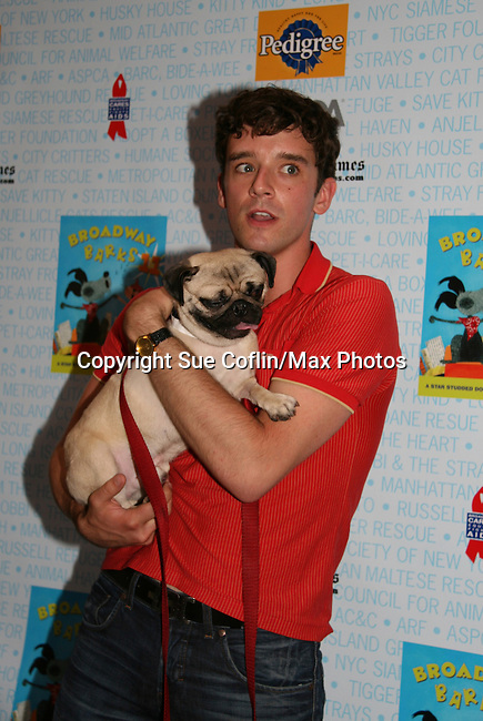 """Ugly Betty's Michael Urie at Broadway Barks 11 - a """"Pawpular"""" star-studded dog and cat adopt-a-thon on July 11, 2009 in Shubert Alley, New York City, NY. (Photo by Sue Coflin/Max Photos)"""