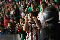 Mexican fans heckle USA fans in the American supporters section protected by Mexican police at Azteca stadium after the USA tied Mexico  in a World Cup Qualifier in Mexico City, Mexico on March 26, 2013.