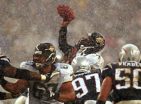Jacksonville Jaguars quarterback #7 Byron Leftwich throws a 27 yard touchdown pass just as he is hit by New England Patriots at Gillette Stadium in Foxborough, MA. (Rick Wilson/Florida Times-Union) .