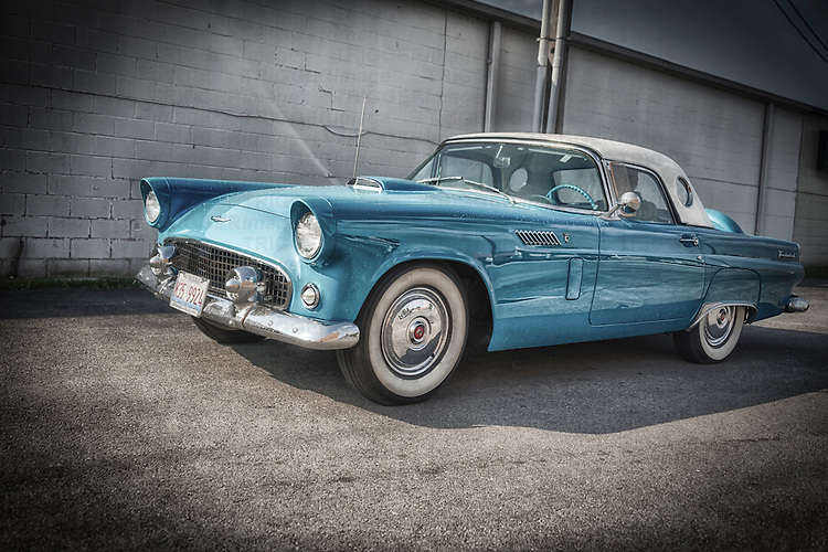 Stunning example of a vintage 1956 Ford Thunderbird convertible in pale blue with whitewall tyres