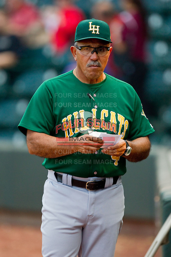 Lynchburg Hillcats manager Luis Salazar (4) checks the lineup cards prior to the game against the Winston-Salem Dash at BB&T Ballpark on August 5, 2013 in Winston-Salem, North Carolina.  The Dash defeated the Hillcats 5-0.  (Brian Westerholt/Four Seam Images)