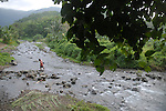 A tourist attempts to cross a river in Ilocos Norte, Philippines..**For more information contact Kevin German at kevin@kevingerman.com