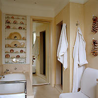 The simple bathroom displays a collection of sea urchins and fans made of shells