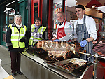 Ann Shortt, Trina Holdcroft, Eddie Tuite and Fergus Lambe with the Pig on a Spit at Tuite's Butchers at The Bull Ring in aid of the Alzheimers Society. Photo:Colin Bell/pressphotos.ie