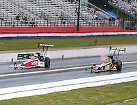 May 19, 2014; Commerce, GA, USA; NHRA top fuel driver Steve Torrence (left) races alongside Tony Schumacher during the Southern Nationals at Atlanta Dragway. Mandatory Credit: Mark J. Rebilas-USA TODAY Sports