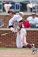 Texas A&M Aggies designated hitter Daniel Mengden (15) follows through on his swing against the LSU Tigers in the NCAA Southeastern Conference baseball game on May 11, 2013 at Blue Bell Park in College Station, Texas. LSU defeated Texas A&M 2-1 in extra innings to capture the SEC West Championship. (Andrew Woolley/Four Seam Images).