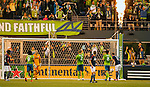 Seattle Sounders Clint Dempsey (2) points to the crowd after scoring a goal against the New England Revolution during an MLS match on March 8, 2015 in Seattle, Washington.  The Sounders beat the Revolution 3-0.  Jim Bryant Photo. ©2015. All Rights Reserved.