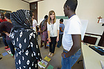 Penny Gushiken leads a cultural orientation class for newly arrived refugees in a church in Lancaster, Pennsylvania. The class, which includes learning common English phrases and verb tenses, is sponsored by Church World Service. <br /> <br /> Photo by Paul Jeffrey for Church World Service.