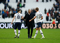 23rd November 2019; London Stadium, London, England; English Premier League Football, West Ham United versus Tottenham Hotspur; Tottenham Hotspur Manager Jose Mourinho congratulates Harry Kane and Harry Winks of Tottenham Hotspur after full time - Strictly Editorial Use Only. No use with unauthorized audio, video, data, fixture lists, club/league logos or 'live' services. Online in-match use limited to 120 images, no video emulation. No use in betting, games or single club/league/player publications