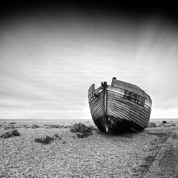 Old fishing boat on the beach at Dungeness Kent England