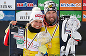 18th March 2018, Winterberg, Germany;  Snowboard World Cup, team parallel slalom. Andreas Prommegger and Claudia Riegler of Austria celebrate their World Cup 2nd place